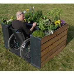 Image of raised bed and wheelchair user
