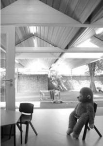classroom with child's toy monkey sat on chair