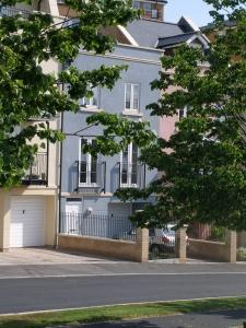 three storey blue terraced houses