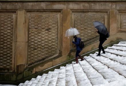 people walking down snowy steps
