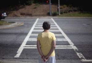 woman stood at road crossing