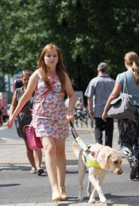 woman walking with assistance dog