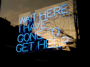 wait here I've gone for help written in neon