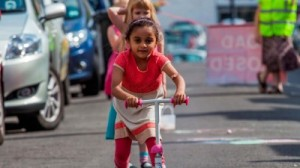child riding a scooter