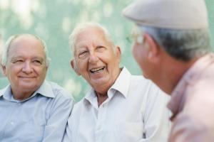group of older men laughing