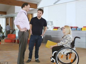 Able person in patronising conversation with wheelchair user