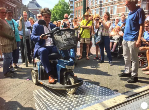 wheelchair user using metal shop ramp