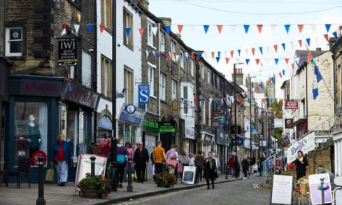 busy small town street with bunting