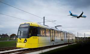 tram with plane flying over